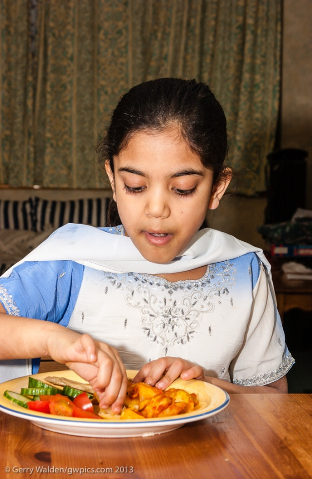 Young Asian Indian girl eating a traditional meal