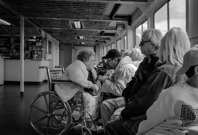 A disabled woman and her partner take a trip aboard the Ellis Island Ferry, New York, USA