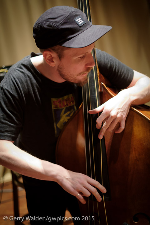 Swedish bass player Petter Eldh at soundchecks with the Marius Neset Quartet in the Turner Sims Concert Hall, Southampton