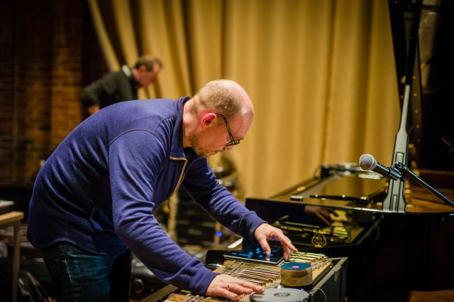 Norwegian painist and electronic keyboard players Brugge Wesseltoft setting up his equipment for a solo concert at the Turner Sims Concert Hall in Southampton, England.