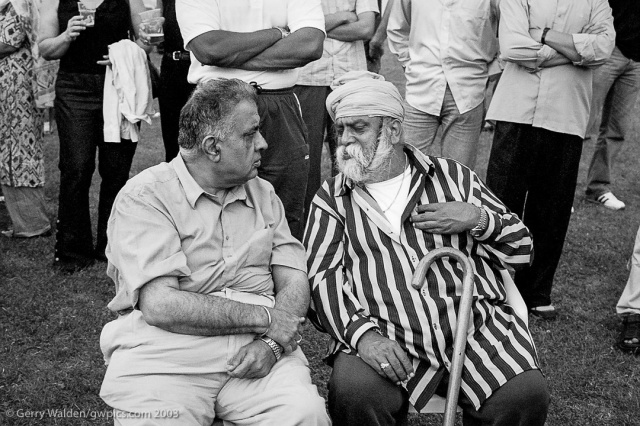 Two men converse together at the Southampton Mela in 2003.