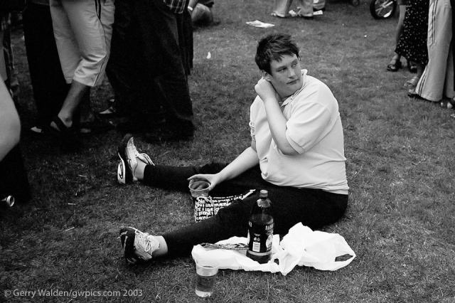 A spectator takes a rest during the Mela festivities in Southampton, England.