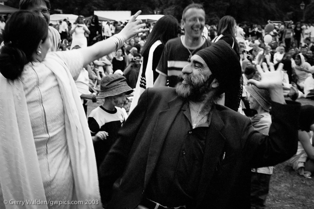A sikh couple dance seductively together at the Mela in Southampton, England.
