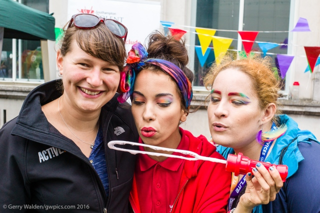 Three girls from the local student population blow bubbles and pose for the camera at the Southampton Pride event, held in the city for the first time in more than a decade.