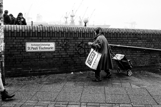 Am elderly woman carries home her shopping from the St. Pauli Fischmarkt in Hamburg, Germany.