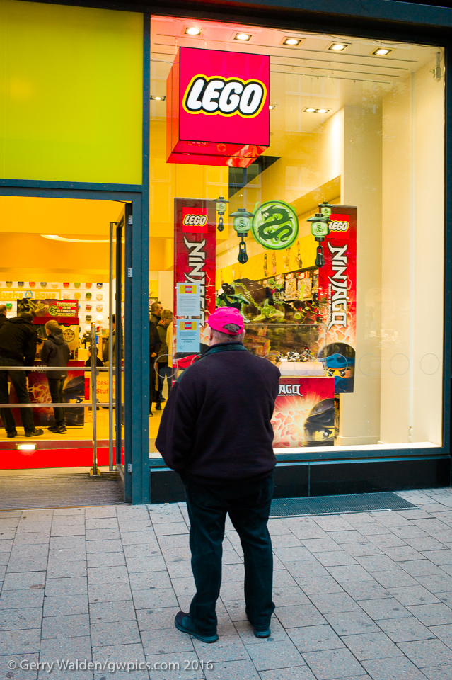 A man waits patiently outside the Lego store in Spitalerstaße in Hamburg, Germany.