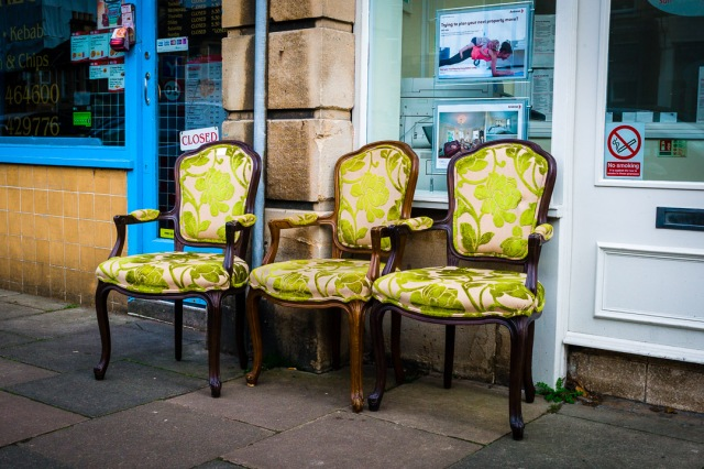 Ornate upholstered chairs at a street market in Bath, Somerset, England.