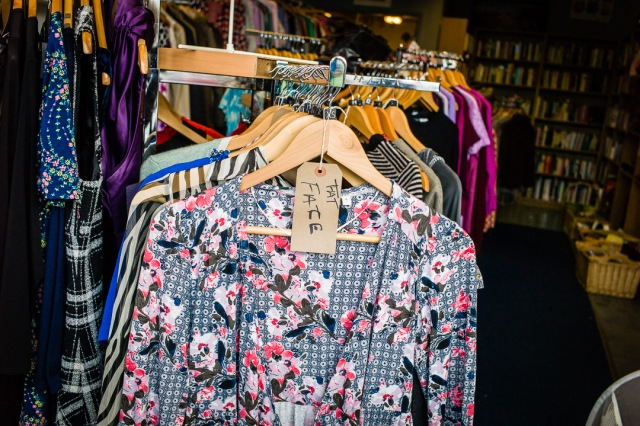 A Fat Face label adorns an extra small item in a charity thrift shop, Bath, England.
